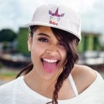 woman with her tongue out in a white unicorn svg hat
