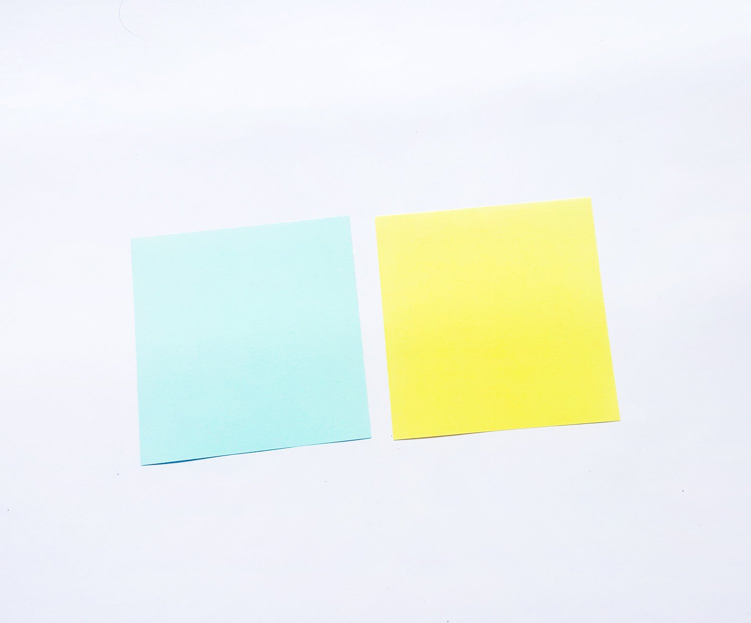 blue and yellow paper on a white background