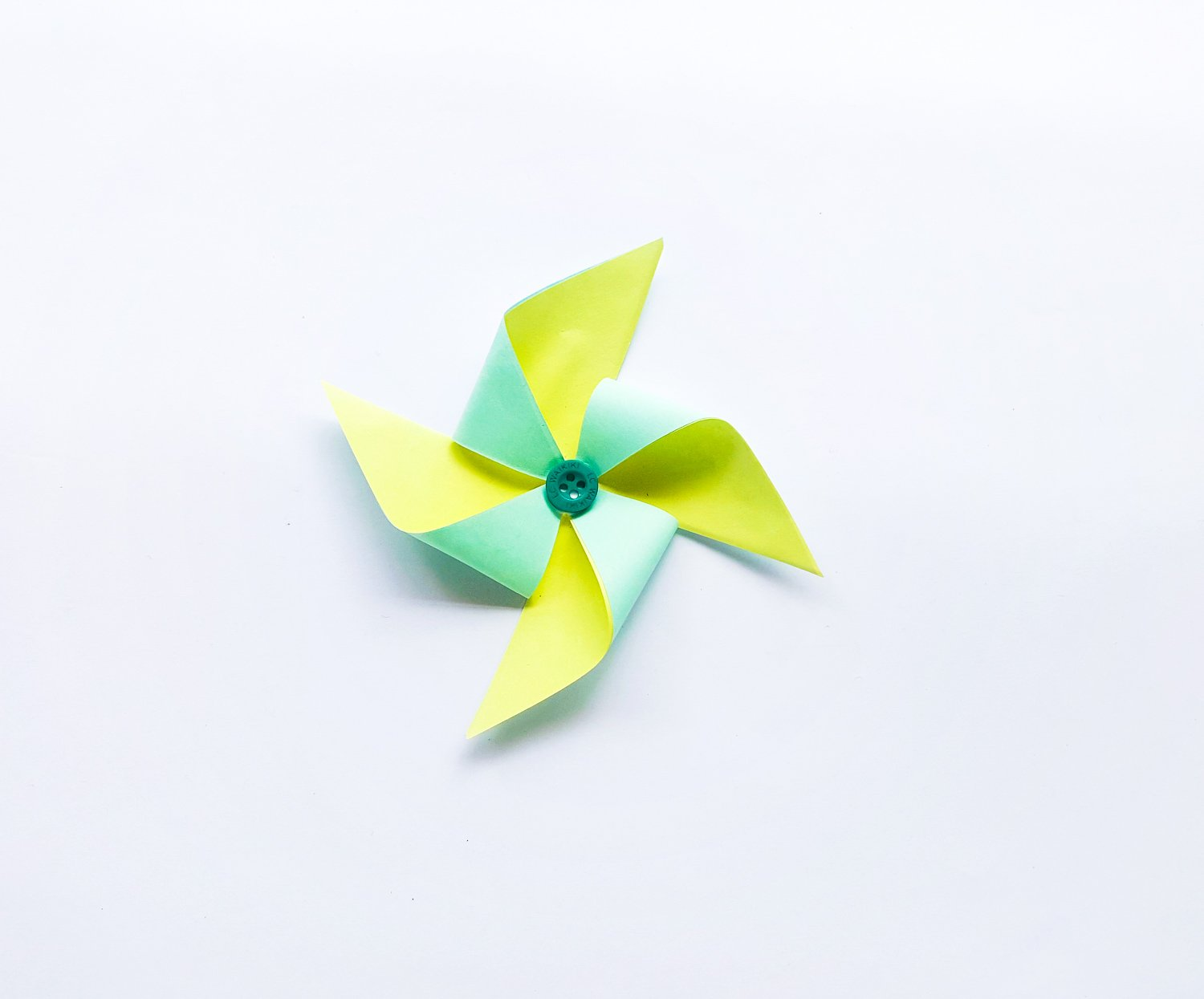 yellow and teal and pink paper pinwheel