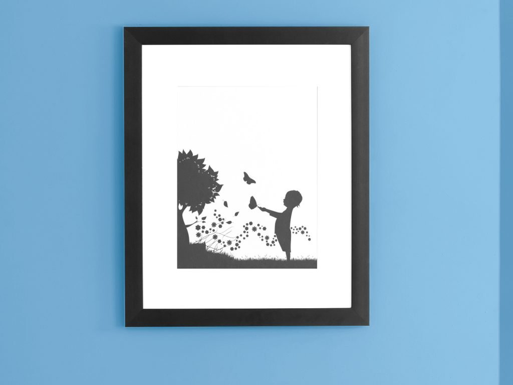 framed diy wall art of a chiled nest to a tree plwuing with a butterfly on-a blue color wall