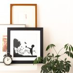 square framed art print near other art prints and a clock with diy artwork