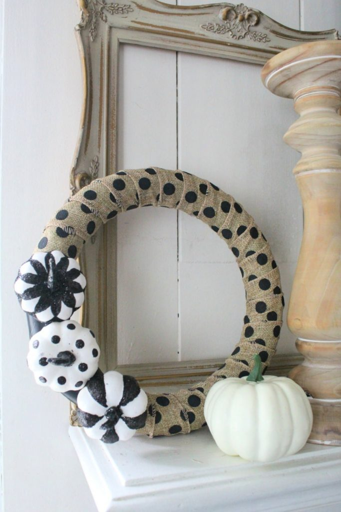 finished halloween wreath with pumpkins