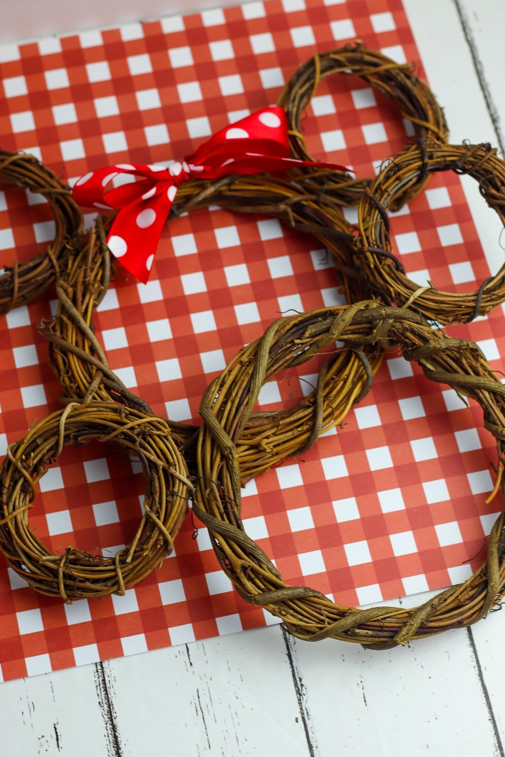 easy Mickey and Minnie Mouse Wreaths on a white wood table with a red and white checkered linen