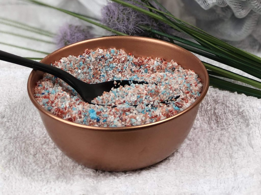 diy bath detox made with epson salt and essential oils in copper bowl with a black spoon