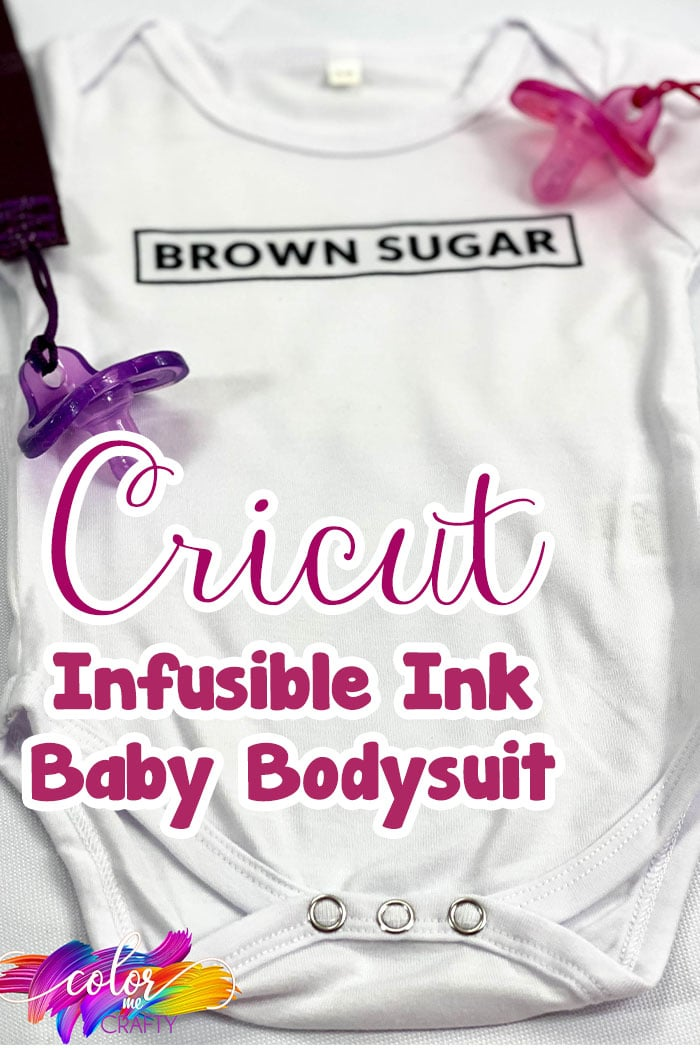 blurry background white cricut baby bodysuit with brown sugar infusible ink design with pink and purple pacifier