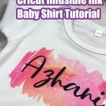 Infusible Ink Baby Onesie on a table with text which reads free cricut infusible ink baby shirt tutorial
