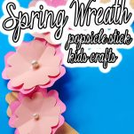 easy popsicle stick frame with text which reads how to make a spring wreath popsicle stick kids crafts