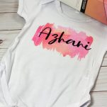 Infusible Ink Baby Onesie on a table