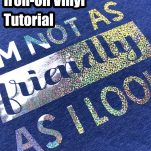 blue t-shirt with silver glittery vinyl lettering with text which reads t-shirt with iron-on vinyl tutorial