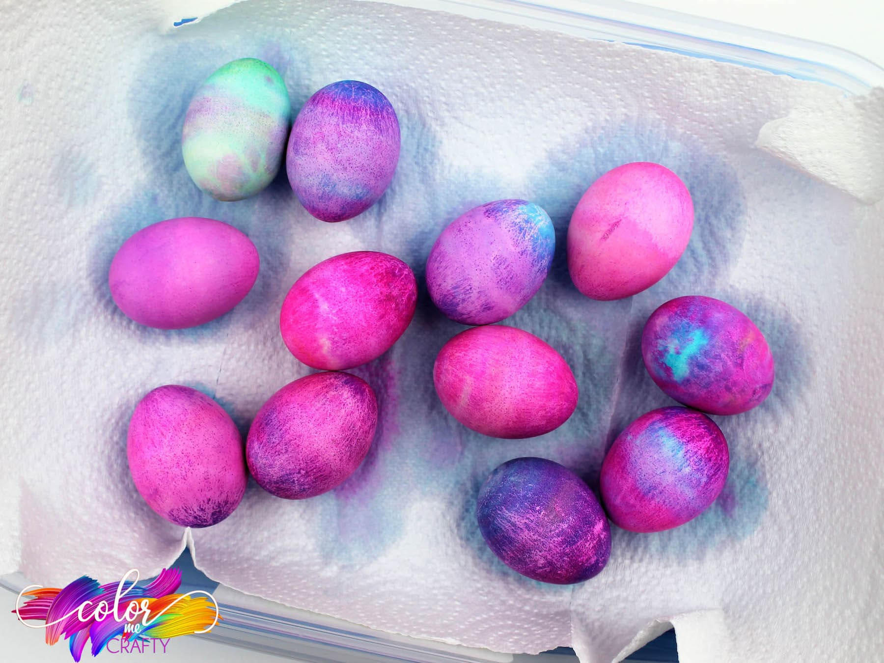 shaving cream dyed easter eggs on a paper towel