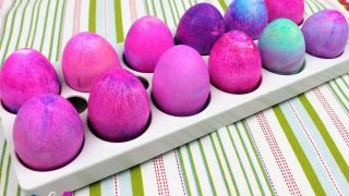 easter eggs dyed with shaving cream on a striped table