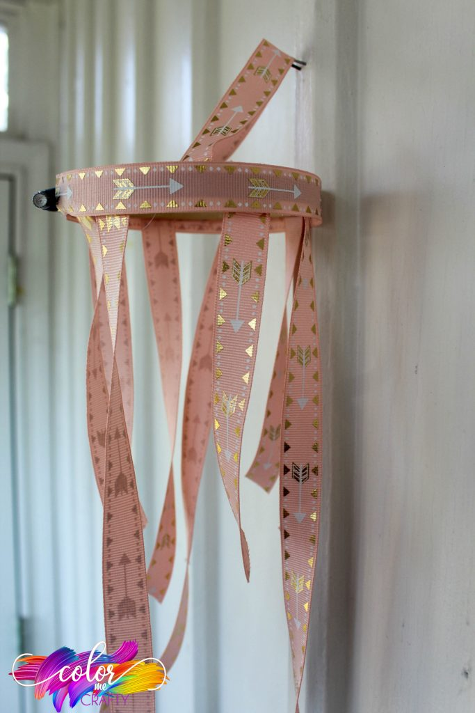 diy chandelier made from pink and gold ribbon