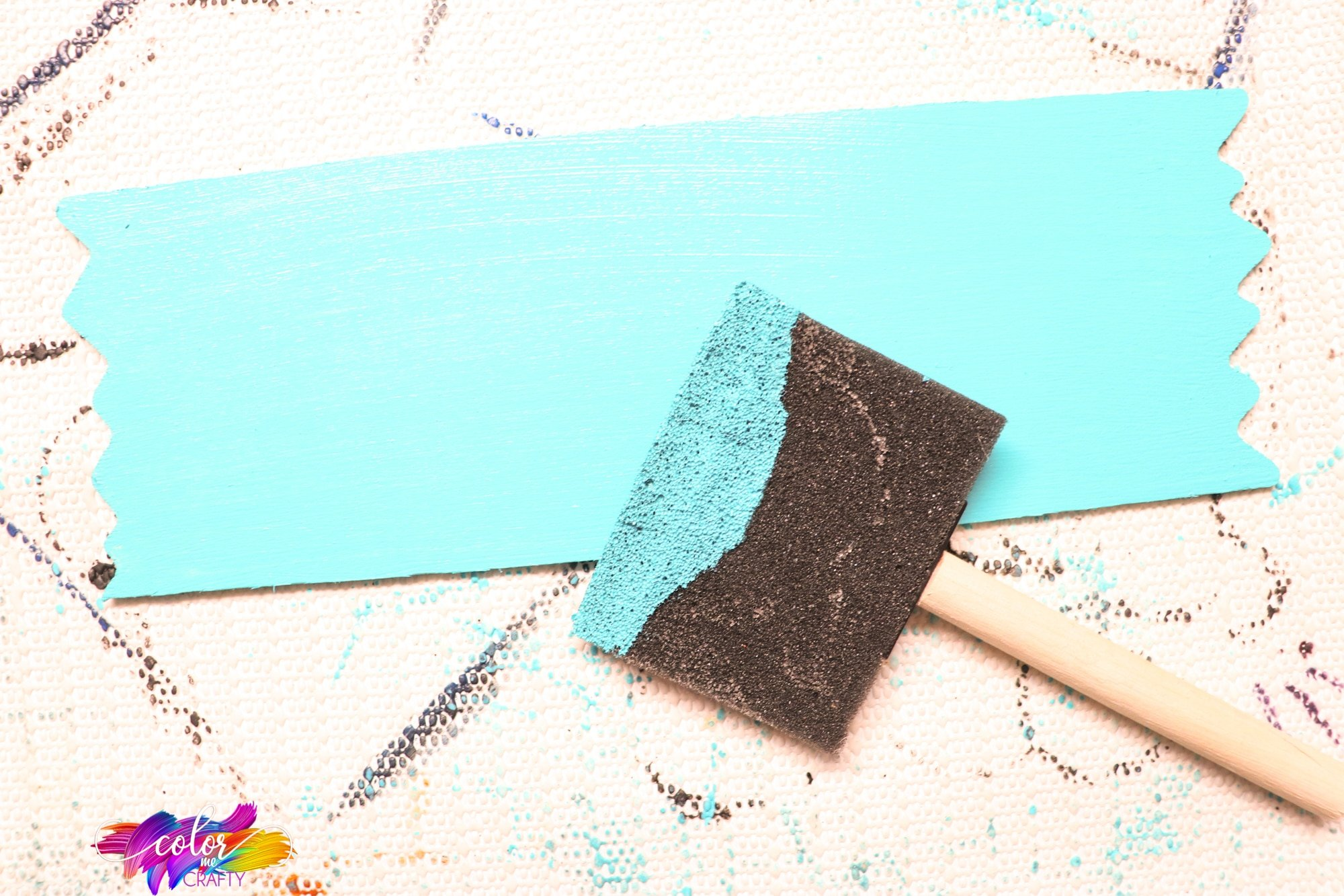 painting a turquoise sign for a farmhosue wreath