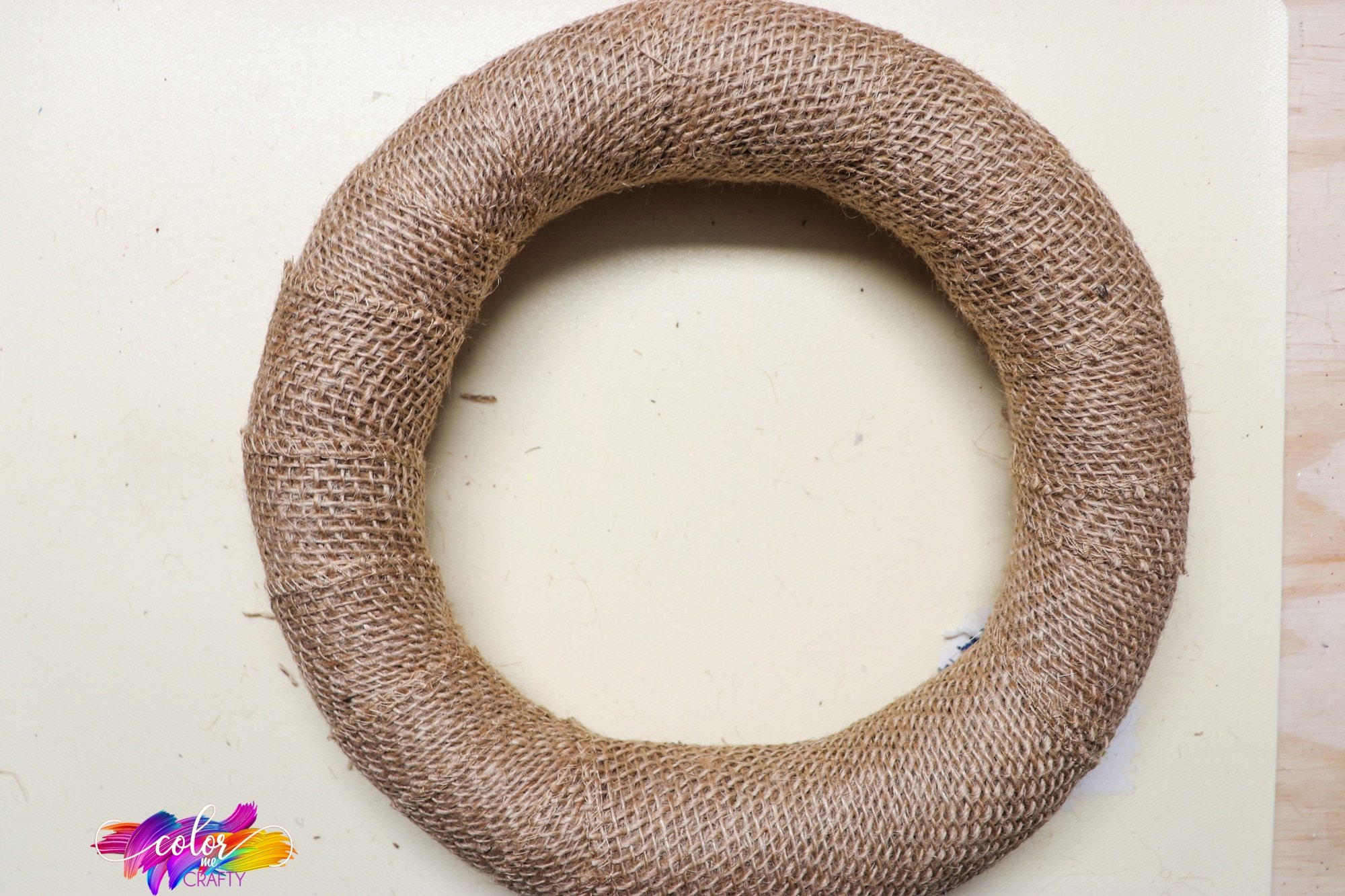 burlap ribbon wrapped around a wreath form