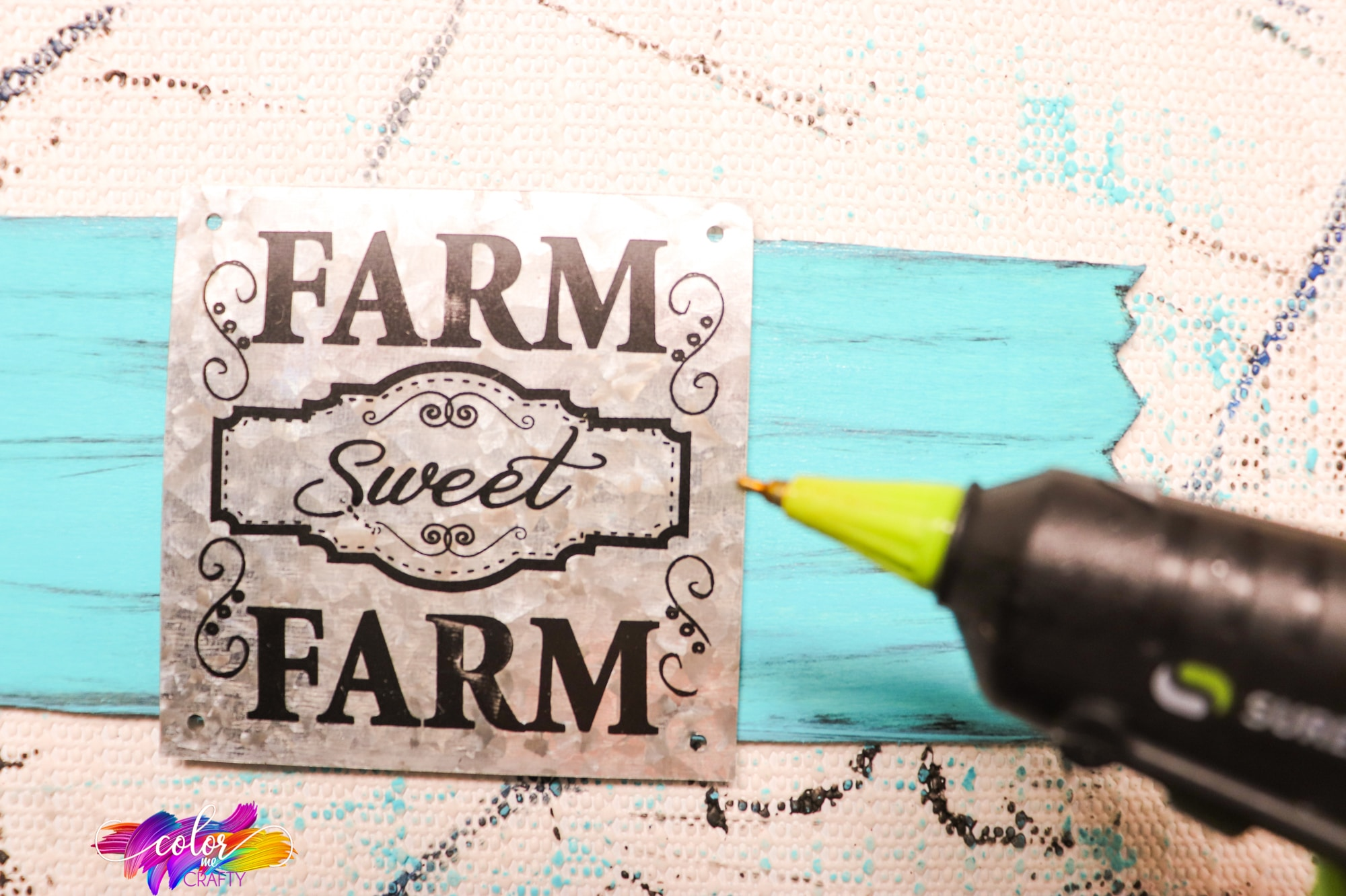 how to affix a metal sign to a wood sign