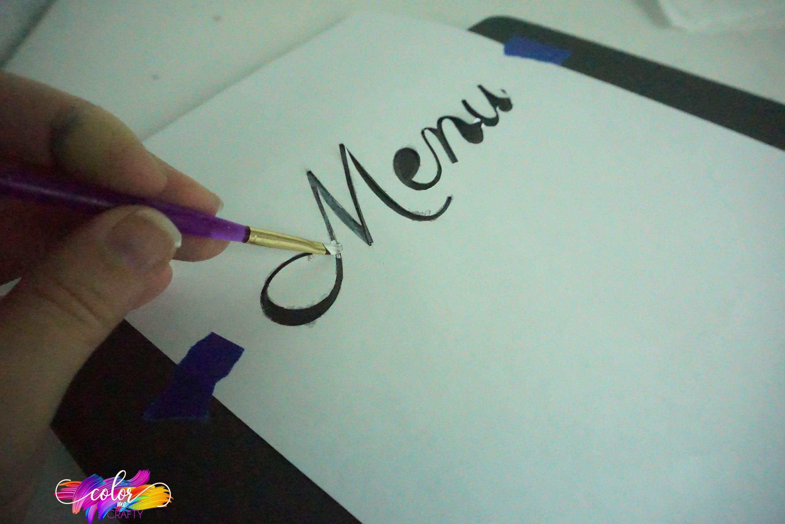 painting a diy menu board