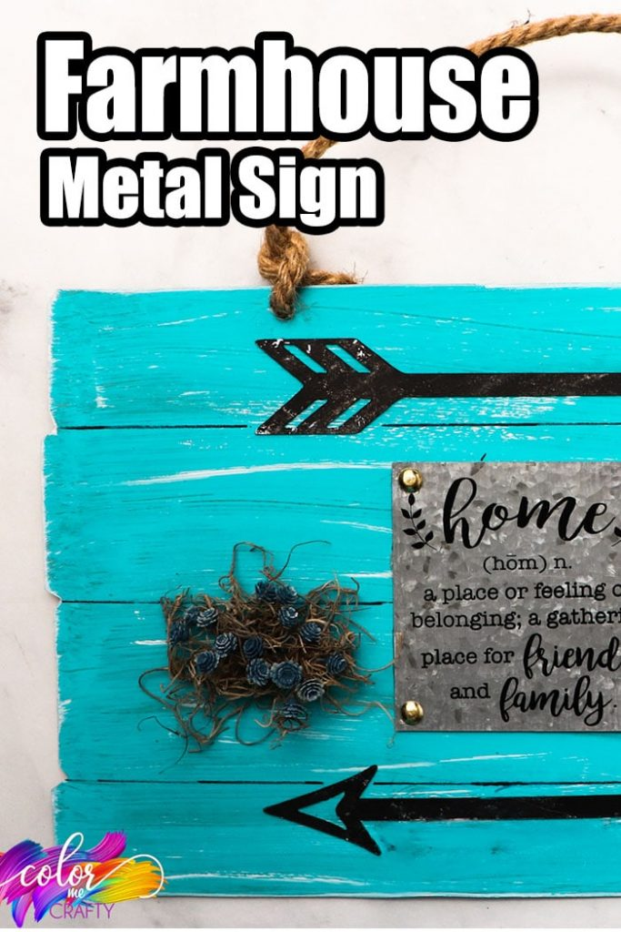 closeup of a diy farmhouse craft idea with text which reads farmhouse metal sign