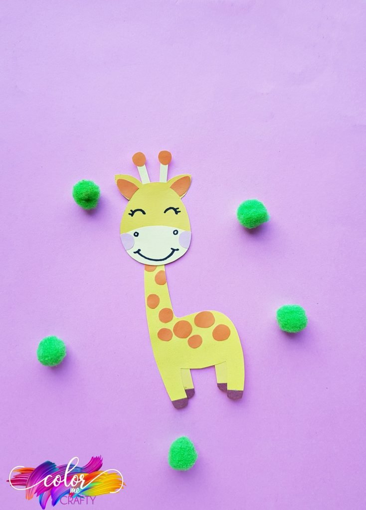 paper giraffe craft on purple background