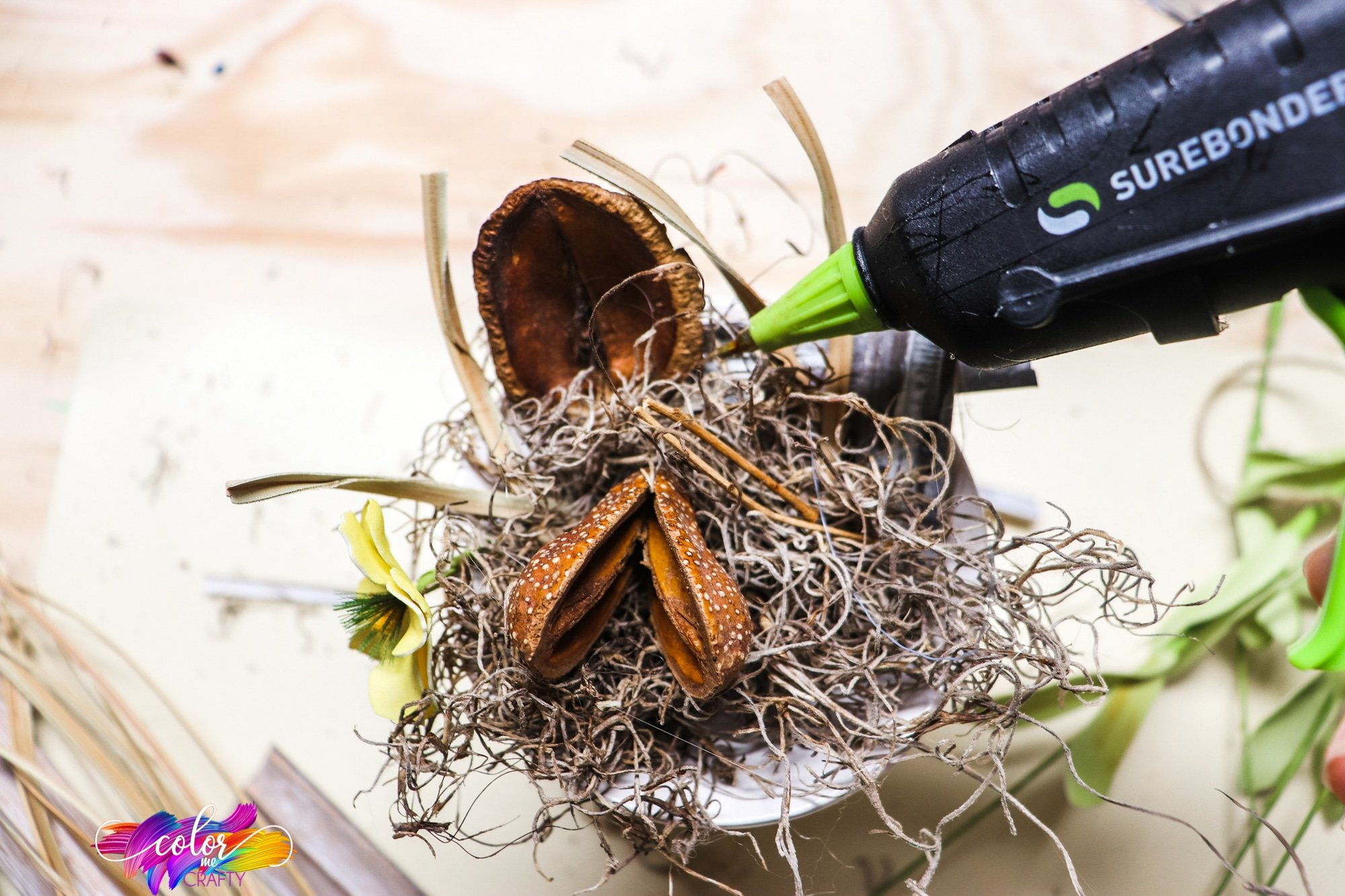 hot glue being used to make a DIY bird nest