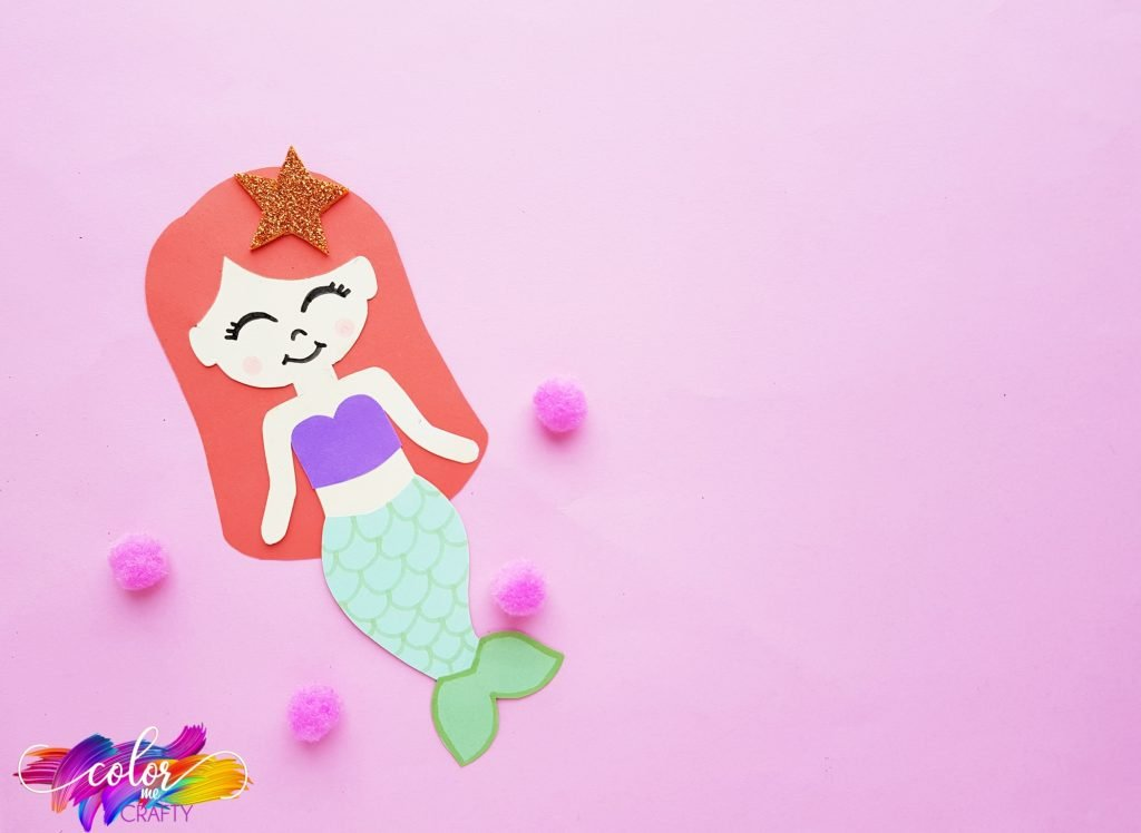 Ariel made out of paper with pink background