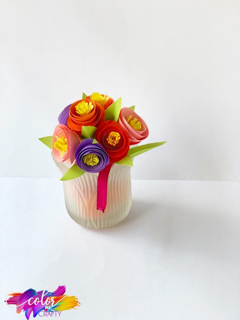 bouquet of construction paper flowers in vase