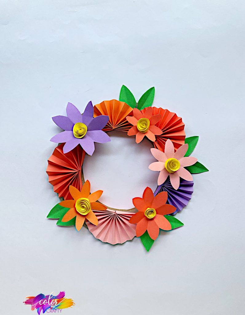 paper flower wreath on plain background