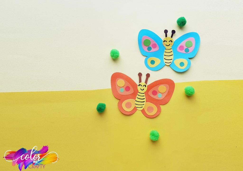 butterflies with green poms