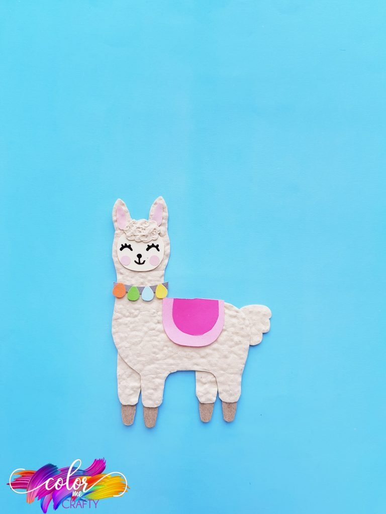 paper llama on blue background