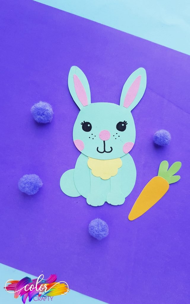 paper bunny on blue background