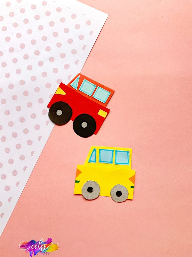 red and yellow paper car on pink background