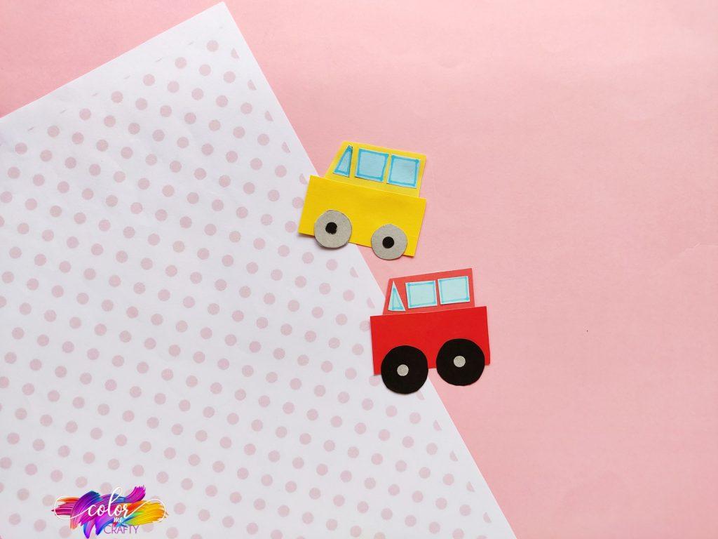 paper car craft on pink polka dot background