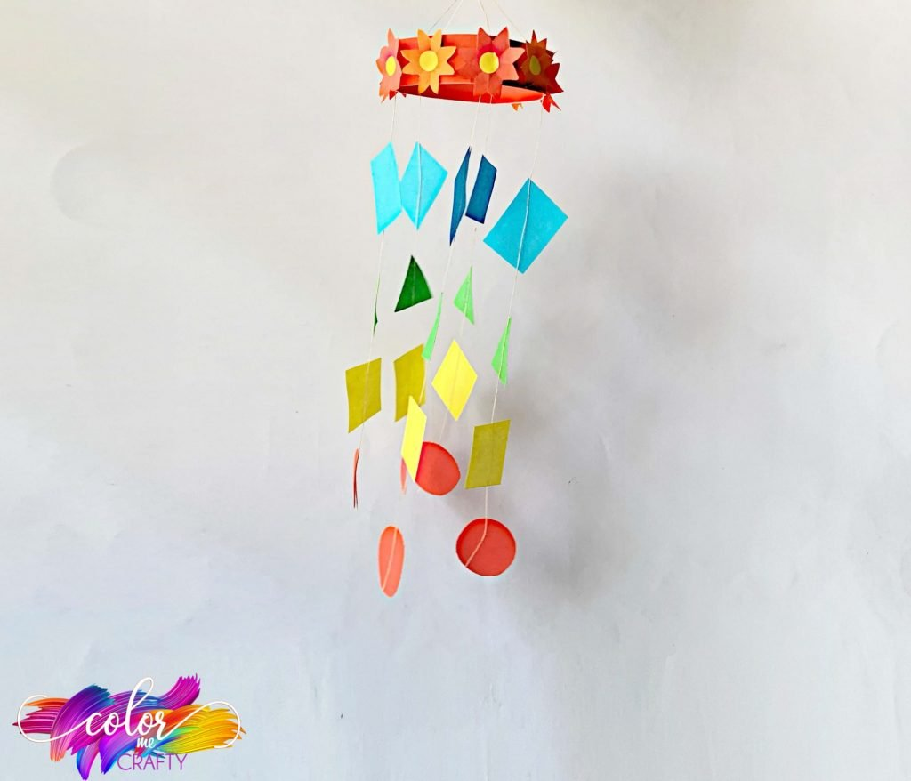 hanging paper mobile with circles, squares, and triangles