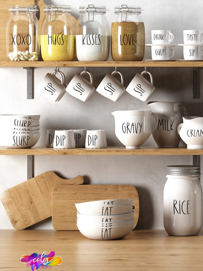 rae dunn kitchenware set on shelves
