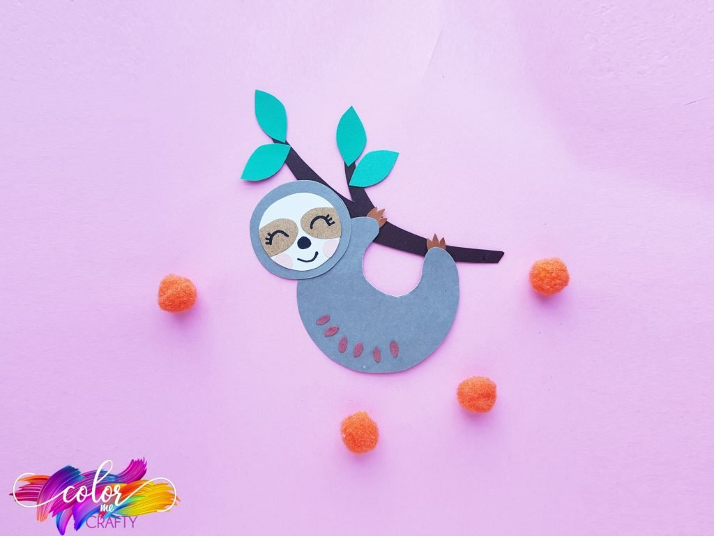 paper sloth craft on branch