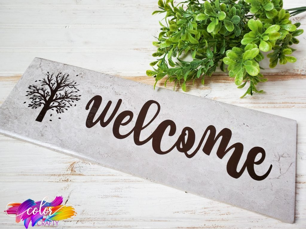 welcome sign with tree