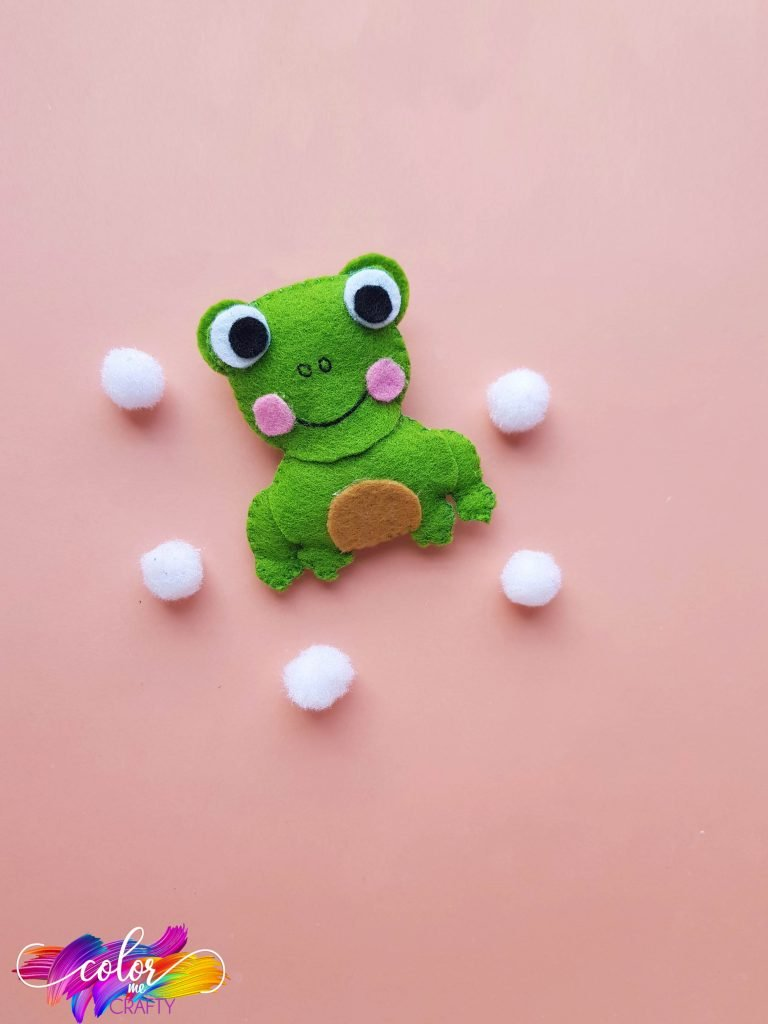 green frog on pink background