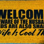 doormat made with vinyl stencils made with the cricut machine and painted with flex seal, says welcome beware of the husband, kids are also shady, wife is cool tho