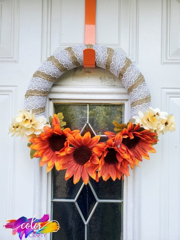 orange sunflower wreath with leaves in between the flowers