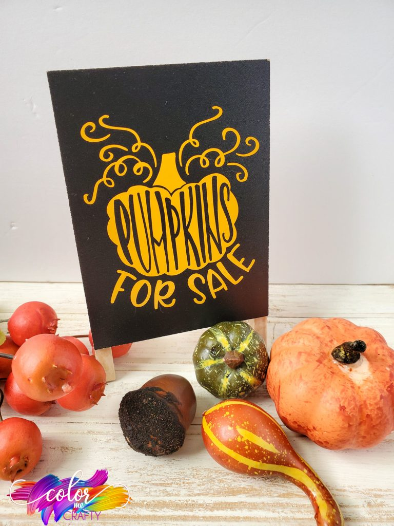 "vinyl sign with black background that reads ""pumpkins for sale"" with a pumpkin on it"