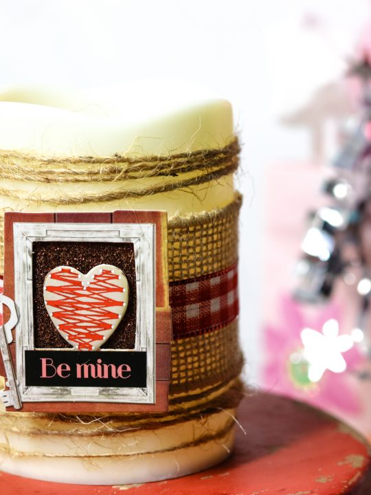 candle centerpiece made from materials found at the dollar tree with a be mine photo on the from and decorative twine around the candle