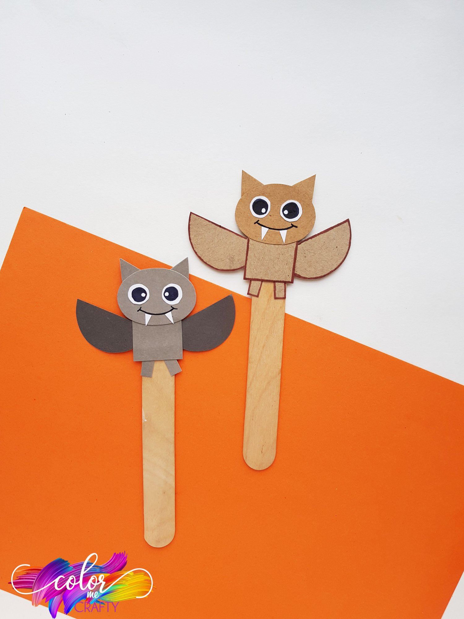 gray and brown paper bat bookmarks on popsicle sticks with cute faces