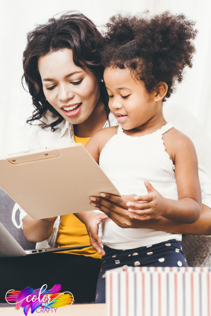 mother and daughter working on clipboard while sitting on a couch finding the child's best learning method