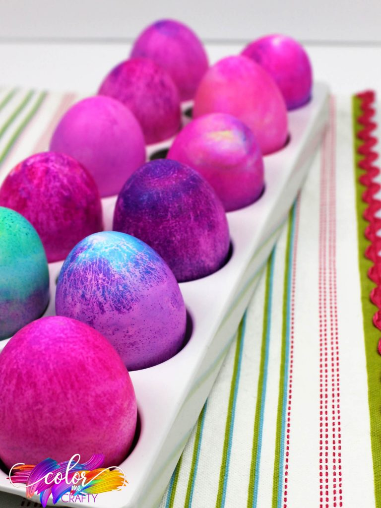 front long view of pinks, purples and blue shaving cream and food coloring dyed easter eggs