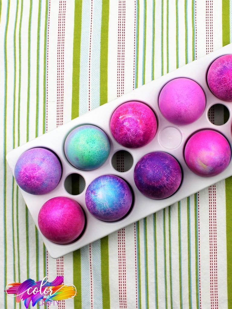 cut off top view of blue and purple dyed easter eggs