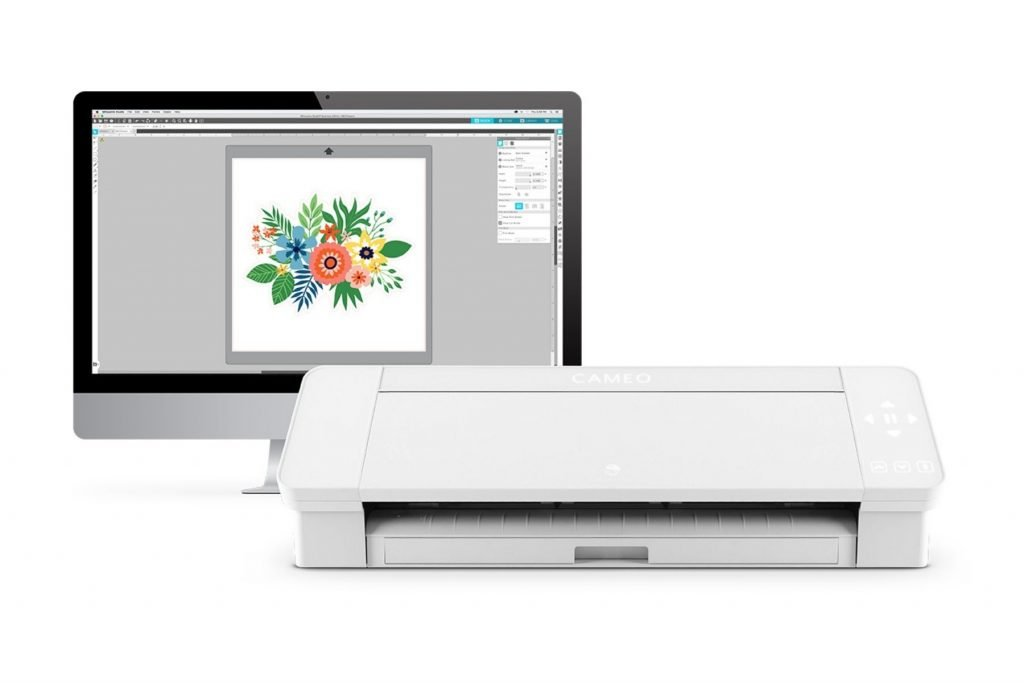silhouette cameo with mac desktop in the background with a flora design on the screen