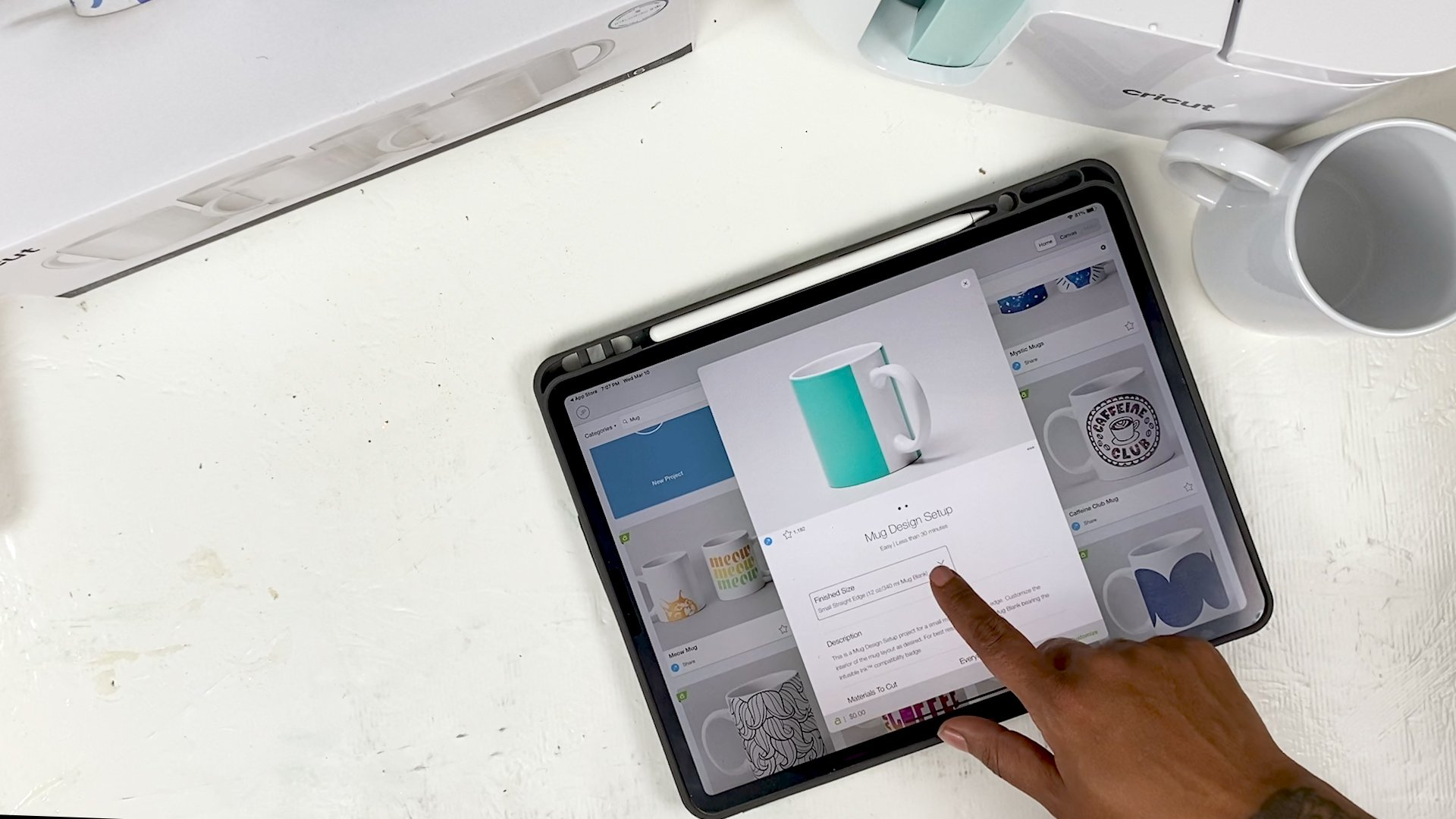 ipad pro 12 on a desk with cricut design space on the screen