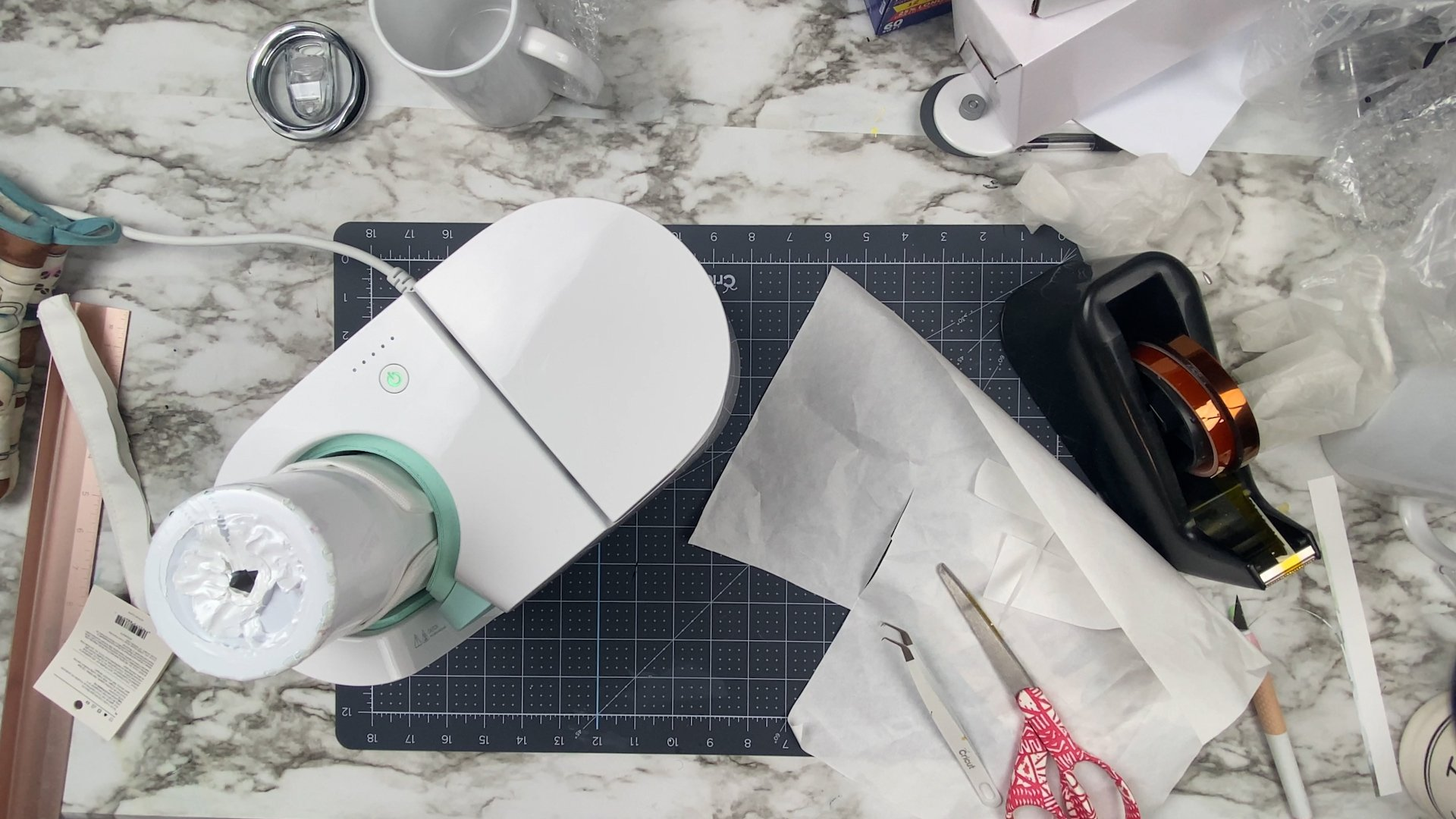 top view of a cricut mug press with a skinny tumbler in it