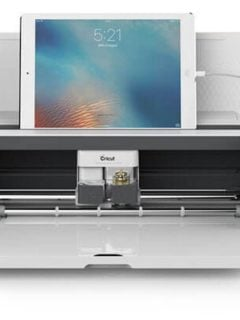 cricut maker with ipad on top of it