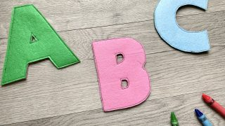 felt letters; green A, pink B, blue C; green, pink, blue, and red crayons on the bottom right