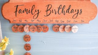wooden family birthday board with wooden chips hanging